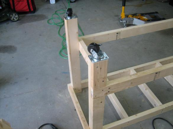 wooden work bench on wheels
